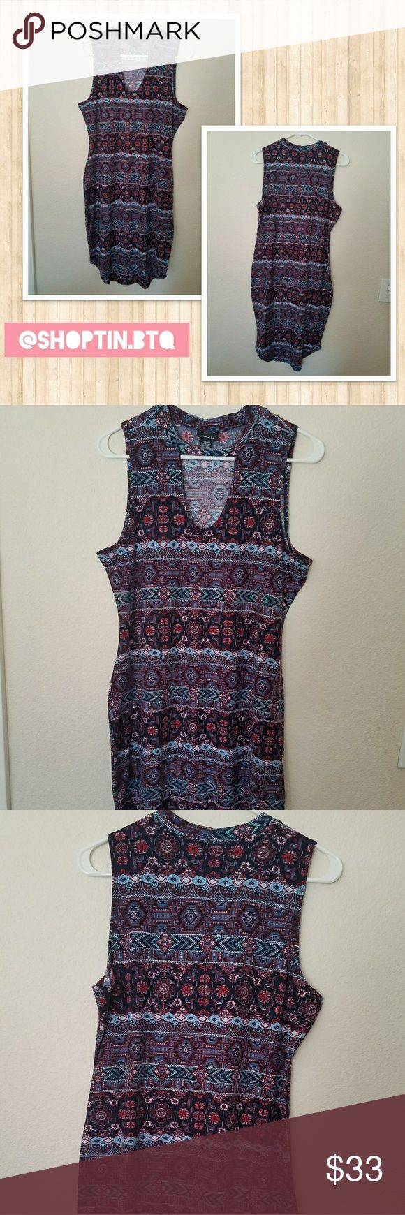 Aztec Keyhole Bodycon Dress Cute flirty bodycon dress in aztec print from Rue21. Complete the look with a moto jacket and wedges for an edgy evening look! Super sexy and gorgeous!   Size Large. Dresses Midi