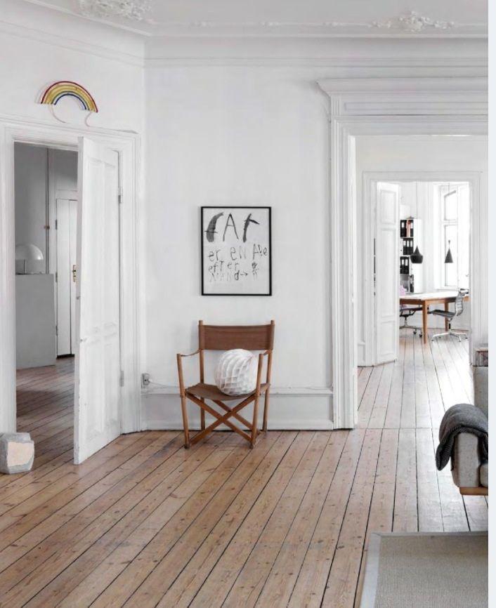 white open space. Classic furniture. Rainbow light above the door <3 Via ignite light