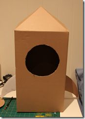 Cardboard Rocket Tutorial.  Has good instructions on how to make pointed top and instrument panel.