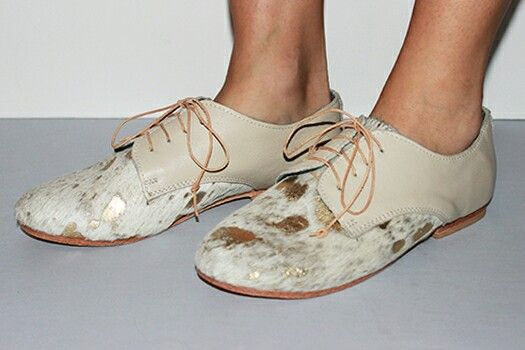 Stunning gold metalic Nguni leather shoes by Matsidiso, South Africa. Ethically handmade shoes with a unique and original touch. Be a fashion leader in these one-of-a-kind shoes!   #southafrica #handmadeshoes #handcrafted #solefood #fashion #shoes