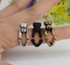 This ring is made in the shape of a boxer that wraps around your finger. They are one size fits all and are plated in silver, bronze and black. This is perfect for anyone looking for unique cute anima