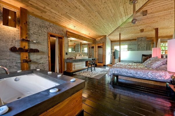 The ultimate dream master bedroom is the loft of a wooden cabin home complete with what else Master bedroom with loft area