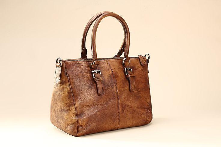 Сумки, рюкзаки : Объемная кожаная сумка на молнии с длинным ремешком