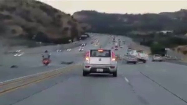 An apparent road-rage crash involving a motorcyclist and the driver of a sedan was captured on cellphone video Wednesday morning on the 14 Freeway in Santa Clarita.  The crash was reported about 5:45 a.m. Wednesday on the southbound side of the 14 Freeway near Newhall Avenue in Santa Clarita, the California Highway Patrol reported.