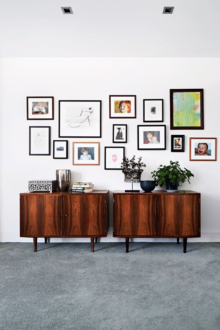 "In the main bedroom, family portraits mingle with vintage artwork and framed prints from La Grolla. Vintage 1960s cabinets from [Grandfather's Axe](http://www.grandfathersaxe.com.au/|target=""_blank""), customised as storage units for vinyl, join other timber notes throughout the home."