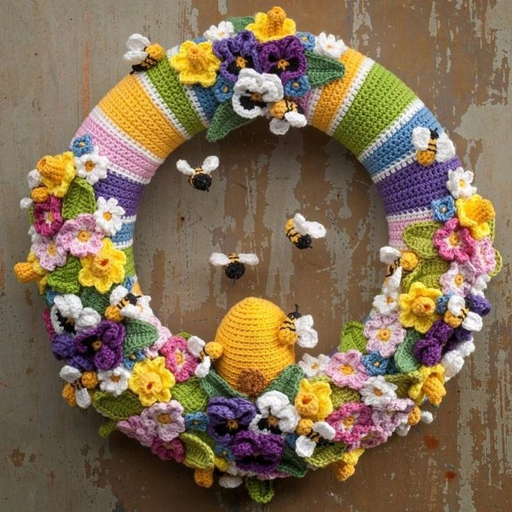 "Crochet a beautiful wreath celebrating my favorite season: spring. Full of spring flowers and buzzing bees, this wreath is sure to bring a smile to your face and make you long for warm spring days!This pattern is translated in English using US crochet terms from my Dutch book ""Kransen haken"" (crocheted wreaths) and is one of the five wreaths that are described in the book.You will get 9 patterns plus the pattern for the wreath cover and a detailed explanation of the techniques used. In total…"