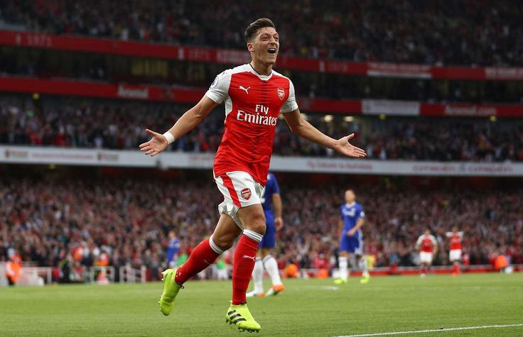 Ozil celebrating his goal before the half, putting Arsenal 3-0 up on Chelsea. // Mesut Ozil produced a magnificent no-look pass against Chelsea (video at link).