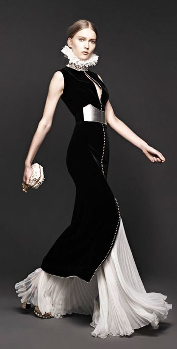 Alexander McQueen Black velvet dress and pleated white skirt. Gorgeous - sans neck ruff of course #alexandermcqueendress