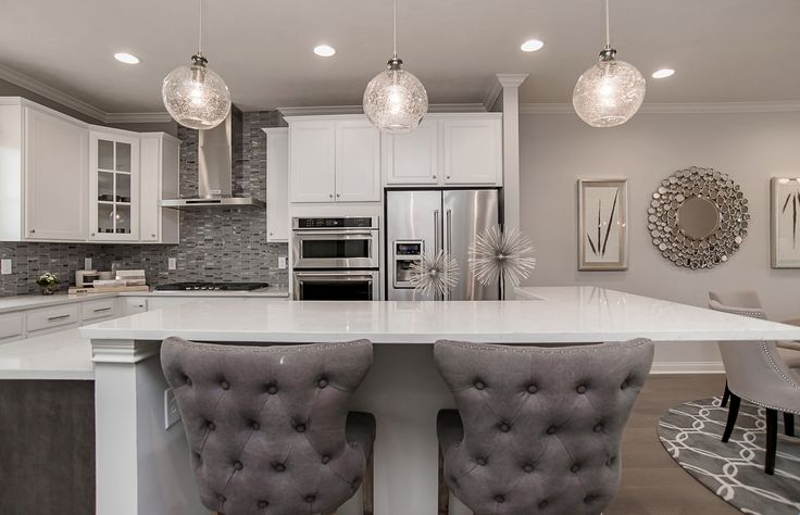 This inviting kitchen is the epitome of refined elegance in chic, soothing grays. | Pulte Homes