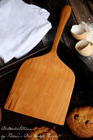 """This enormous wooden spatula started out as a custom order from one of our customers and we liked it so much, we decided to add it to the shop! It's hard to show with a picture how large this handcrafted spatula really is. It features a 6"""" wide spatula """"blade"""" for conveniently removing multiple cookies from a cookie sheet at once, or for flipping large pancakes on a flat griddle. The best part is the sturdy, short handle that makes the whole utensil feel manageable and balanced."""