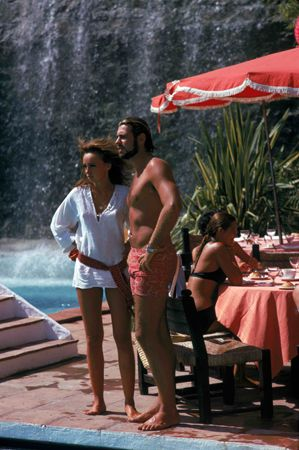Marbella Club Couple    Bathers at the Marbella Club, Marbella, Spain September 1970.  Slim Aarons