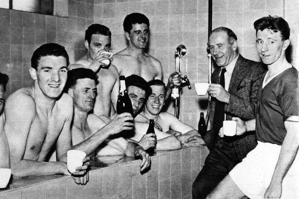 Matt Busby Manchester United celebrating winning the Division One League Championship 1956-1957 for the second year running