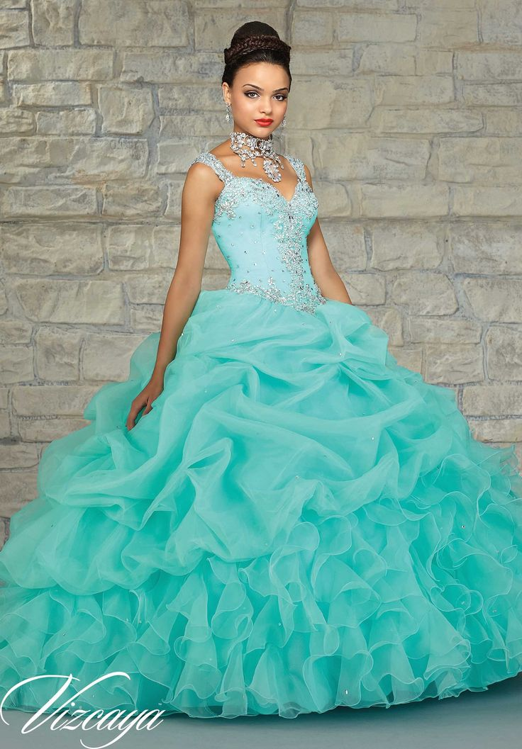 Mori Lee Vizcaya Quinceanera Dress Style 89023 is made for girls who want to look like a beautiful Princess on her Sweet 15. Made out of organza, this ball gown features straps with a sheer beaded bac