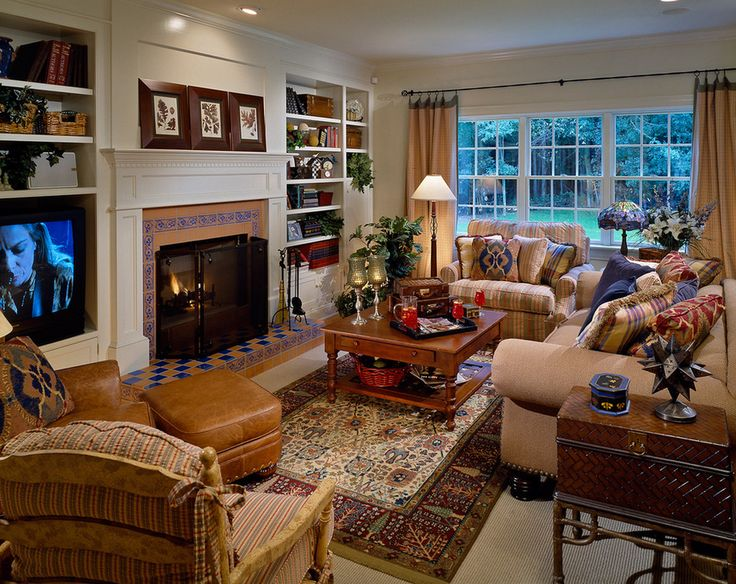 This sitting/living room has separate areas for conversation and watching TV, all brought together with a warm color scheme. Especially like the coffee table and built-in bookcases.