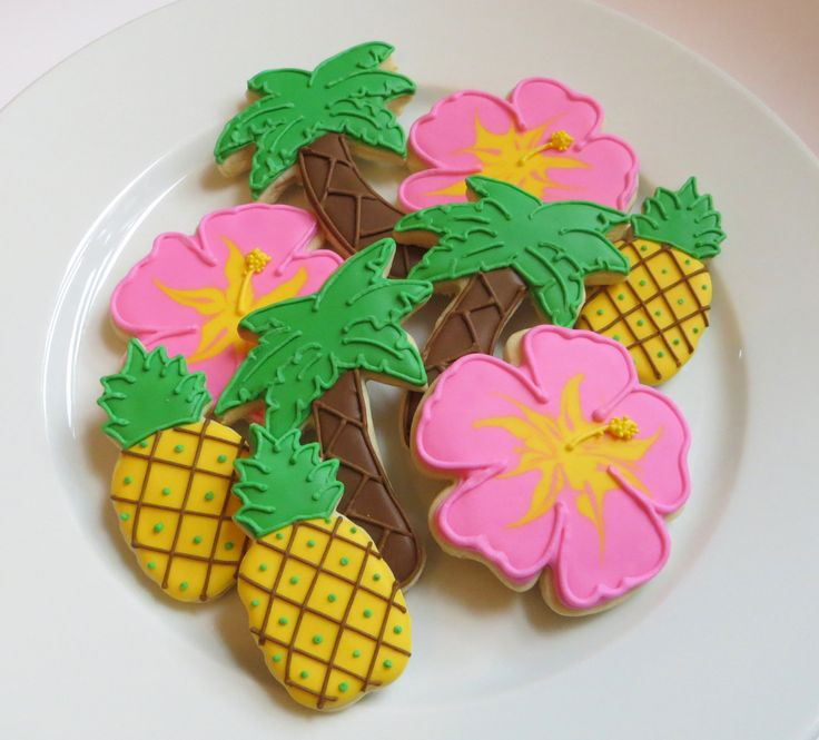 Tropical decorated cookie favors: hibiscus flowers, palm trees and pinapples, 1 dozen. $39.00, via Etsy.