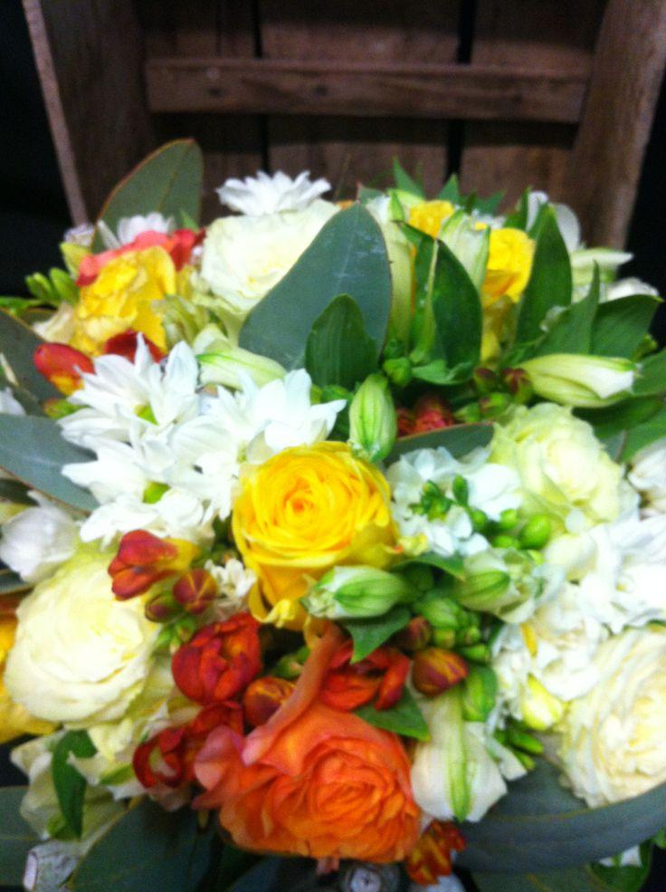 mix of roses, freesias,chrysanthemum,alstromeria and gum nuts