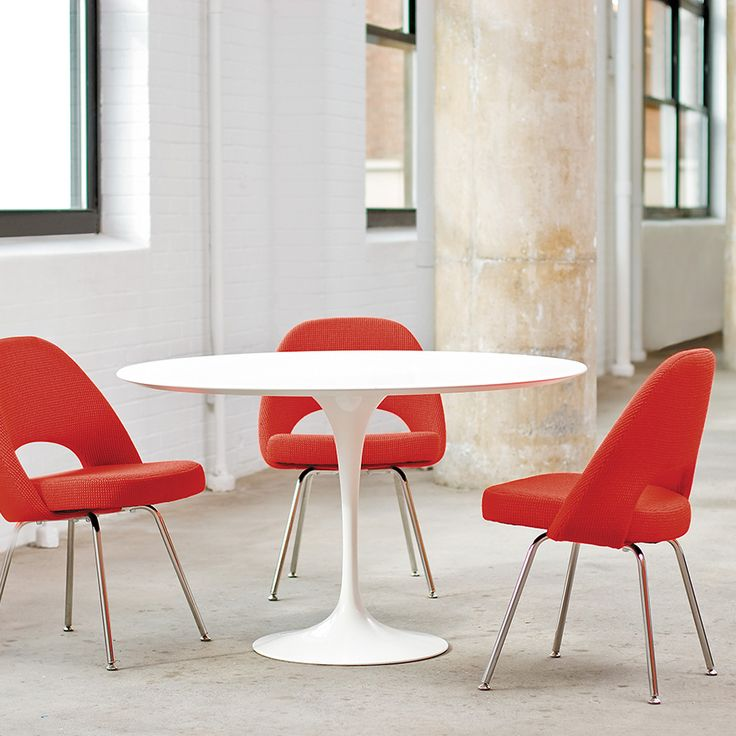 saarinen dining table round by knoll eero saarinen vowed to address the u201cugly confusing unrestful worldu201d he observed underneath chairs and tables the