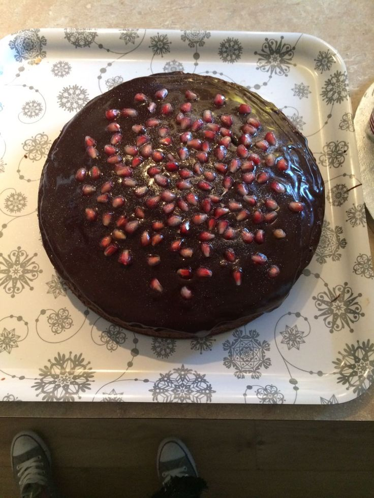 Chocolate cake decorated with pomegranate and edible glitter ✨