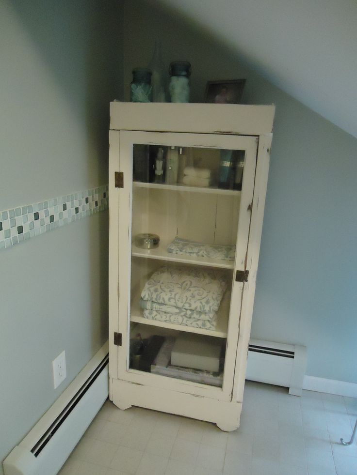 Old repurposed glass door cabinet, perfect for toiletries in any bath.