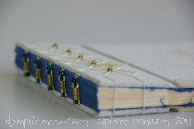 Papieren Avonturen: japanese style stab binding - love the seed bead accents and the contrasting deckle edge of handmade paper on the interior