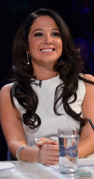X Factor's #Tulisa wearing #Folli Follie's Bling Chic earrings, stack of Match and #Dazzle bracelets and Match and Dazzle dome ring in this Saturday's episode of The #X Factor.