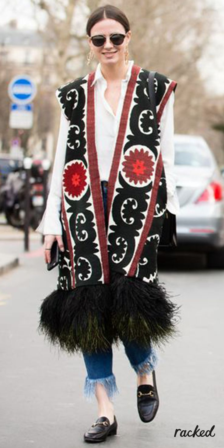 A Red, Black & White Embroidered Vest With a Fur Trim at Paris Fashion Week // More Transitional Style Ideas from the Best PFW Fall 2016 Street Style: (http://www.racked.com/2016/3/3/11151322/pfw-fall-2016-street-style)