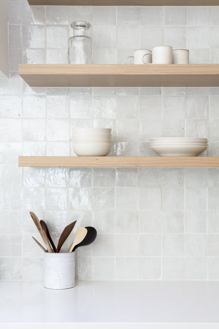 These walnut floating shelves are stunning! The backsplash has a cool glaze as well. Sweetness