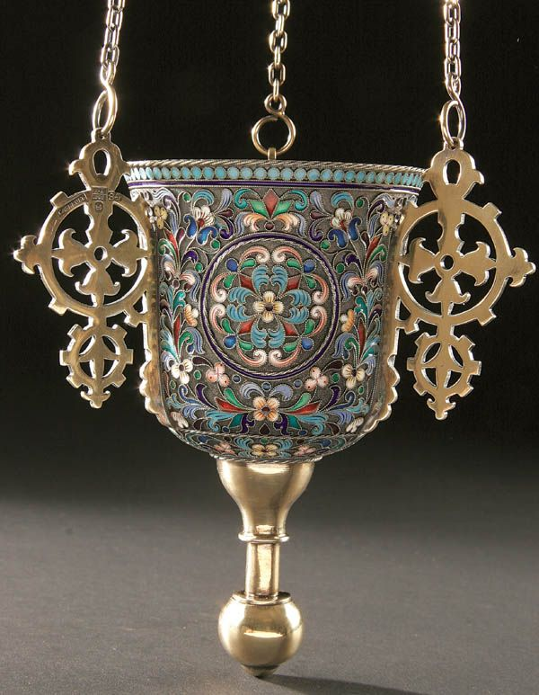 A RUSSIAN SILVER GILT AND SHADED ENAMEL ICON LAMPADA (oil lamp) - Moscow 1891. The body overall enameled in scrolling foliage, hallmarked Moscow, 84 standard, dated 1892 and in Cyrillic SAZIKOV. The interior gilded and with three suspension chains and silver smoke bell. Overall height including chains 27 inches.