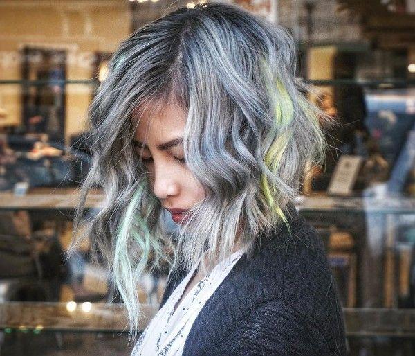 gray and light green highlights and asymmetric bob