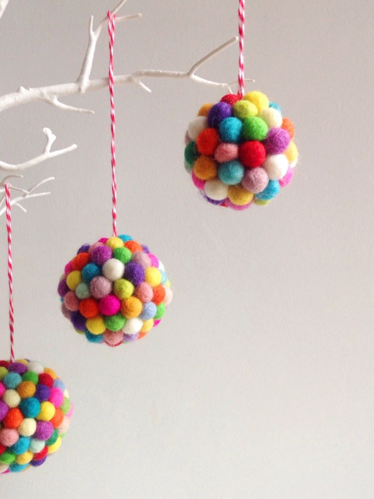 Tiny pompoms make old baubles  look cool and contemporary for Christmas, cute makes  for kids
