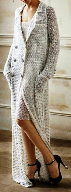 Chanel... lovely but those heels and the length of that sweater... hmmm looks lethal. a bit shorter and I love it!