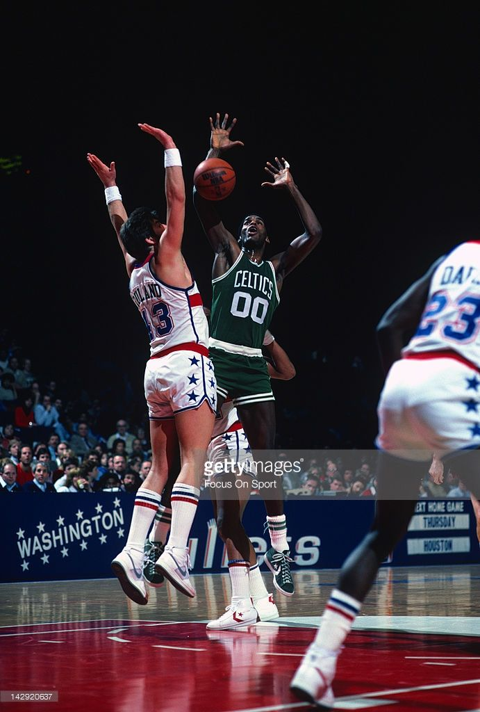 Robert Parish #00 of the Boston Celtics battles for the ball with Jeff Ruland #43 of the Washington Bullets during an NBA basketball game circa 1984 at the Capital Centre in Landover, Maryland. Parish played for the Celtics from 1980-94.