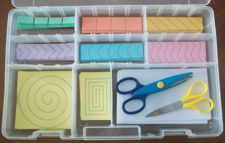 Scissor cutting bin of different patterns for the students to cut out.