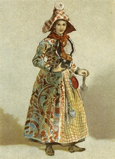 """Berg Fashion Library -- """"Print of a woman wearing Hindeloopen regional dress, probably 1880s. The town of Hindeloopen in Friesland, the Netherlands, was well known for its highly distinctive forms of dress. The layered plain and patterned clothing that combined floral chintz and checked fabrics varied depending upon the marital status of the woman. Decorative ornaments also signified status, as did the carefully folded headdress. This type of regional dress gradually disappeared at the end…"""