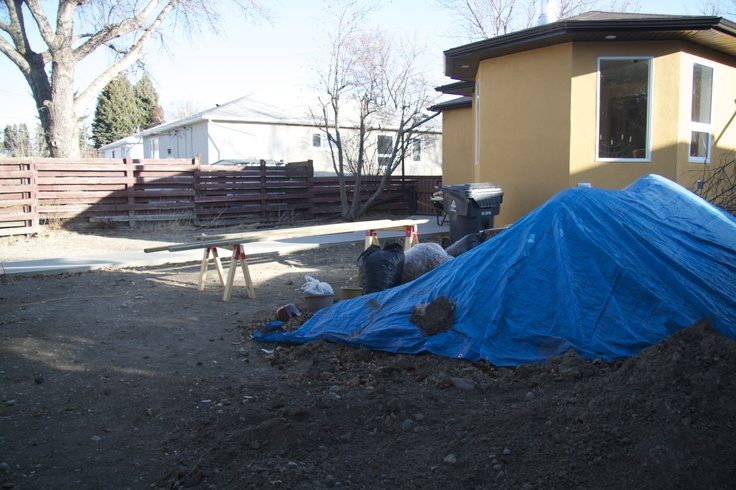 Under the blue tarp is good quality top soil.
