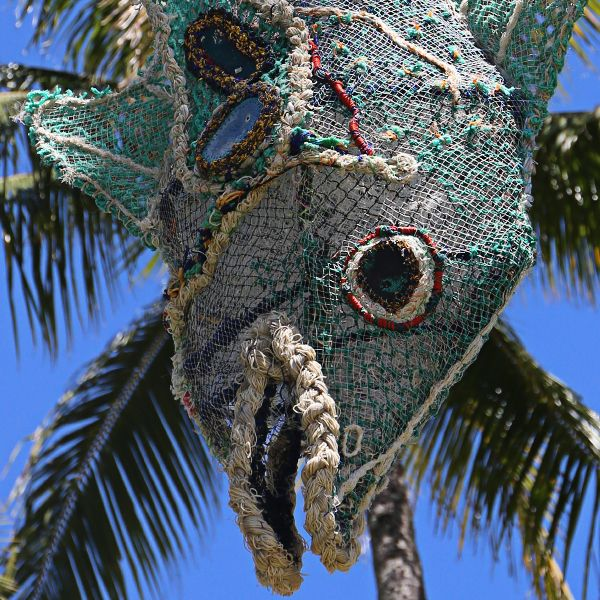 Fish Monger sculpture by Lynette Griffiths made from ghost net, steel and Floatsam - Esplanart, Cairns, Australia 2014