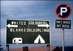 Apartheid SA. Muizenberg. Sign indicating different areas for white and coloured campers. 1984.
