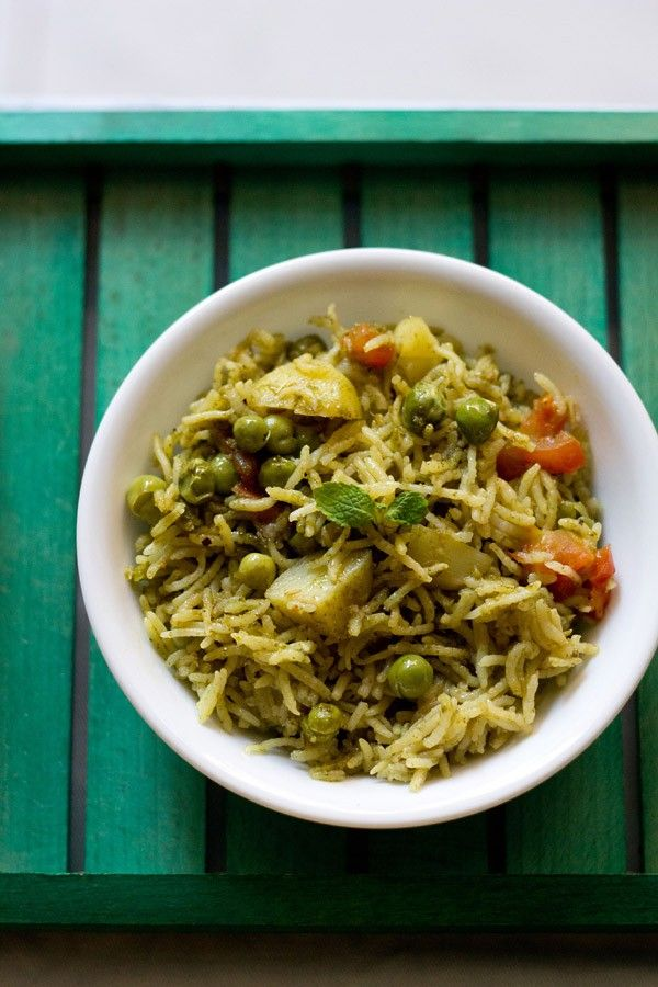mint rice or mint pulao recipe with step by step photos - a spicy one pot fragrant mint pulao recipe.    mint (pudina in hindi), a fragrant herb is used in indian cuisine in different ways. this
