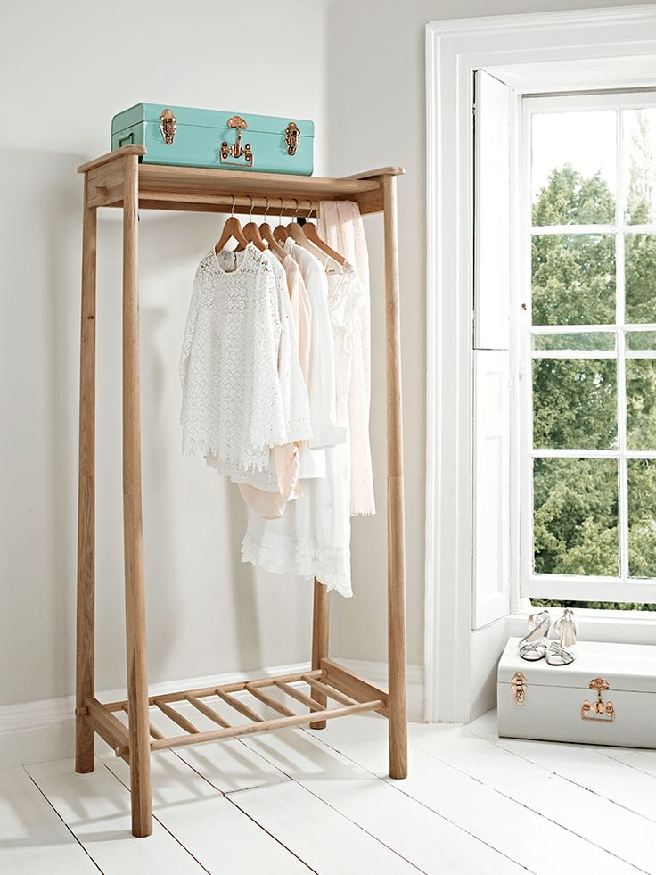 Beautifully crafted from solid oak with a smooth finish, visible wood grain and circular join details, our elegant clothes rail is a wonderful way to display your favourite garments. With a handy slatted shelf for extra storage space and a slender, tapered silhouette, the Scandinavian inspired design will sit perfectly in your bedroom or dressing room.