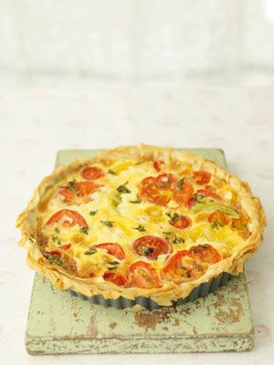 Jamie Oliver's late summer tomato tart (This is a delicate French-style tart. I'm using filo pastry and just a small amount of filling to keep it thin and crispy, so the real heroes in the taste department are going to be the tomatoes. Using a variety of different-coloured tomatoes on top of the tart makes it look incredible. And opt for a really good artisan Cheddar, such as Montgomery's or Keen's - it'll add a lovely sharpness.)