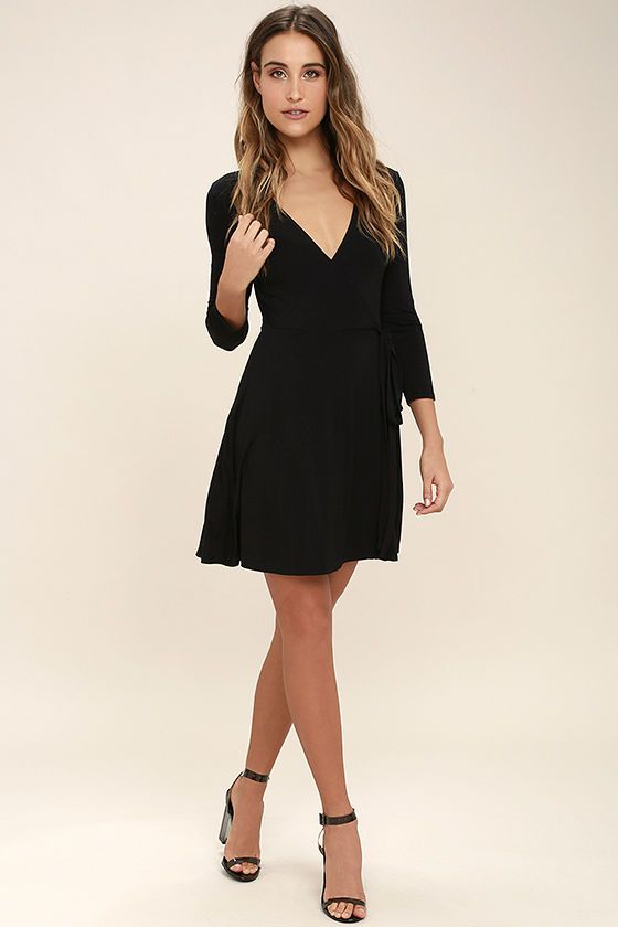 Wow them in classic style with the Twirl-Worthy Black Wrap Dress! Soft jersey knit fabric sweeps down fitted three-quarter length sleeves into a wrapping surplice bodice with tying sash belt. Lightly flared skirt falls to a flirty hem.