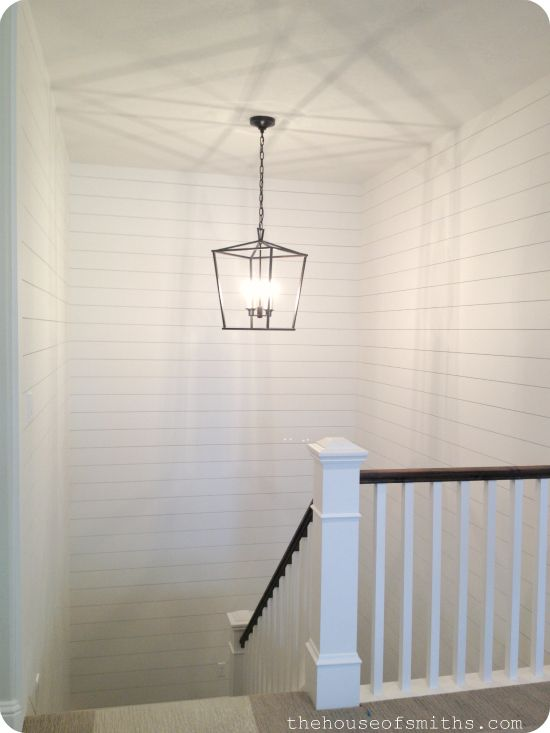 The House of Smiths parade of homes tour, Salt Lake City, UT. Plank wall up stair landing, black iron ceiling pendant.