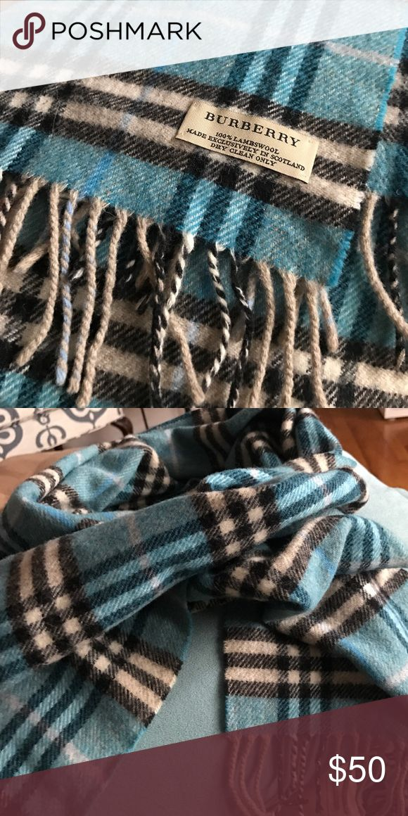 Burberry plaid scarf Blue black and white Burberry plaid scarf. 100% lambswool. Open to offers Burberry Accessories Scarves & Wraps