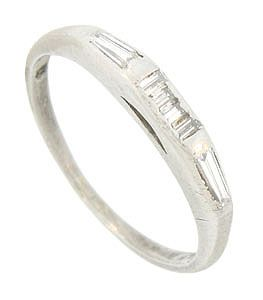 A sparkling combination of tapered and rectangular baguette diamonds adorn the face of this vintage platinum wedding band. The spectacular wedding ring measures 2.88 mm in width. Circa: 1950. Size 6. We can re-size.