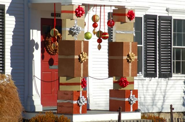 These outdoor Christmas decoration ideas are equal-opportunity offenders. Whether you like your decor showy or tasteful, you'll hate (or love) them.: Porch Columns Decorated With Christmas Gift Boxes
