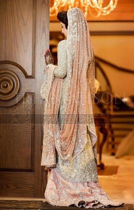 Pakistani bride   irfan ahson photography   wedding photography   pose to show back of dress   cream colored bridal dress with peachy dupatta and lehenga   walima or nikah dress