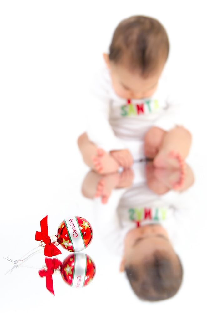 Kid's Christmas picture with Christmas ornament  Central Massachusetts Baby Christmas Pictures - Dudley, MA - Carlo Vivenzio Photography