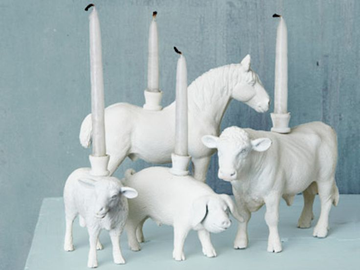 So what happens to all those old plastic toy animals or wooden figures you've inherited that frankly are really outlived their use? Grab a candle holder, fix to the top of each animal with a screw (Amazon.com sell menorah candle holders which are ideal for this purpose, paint or spray white and a new generation of candlesticks are born.