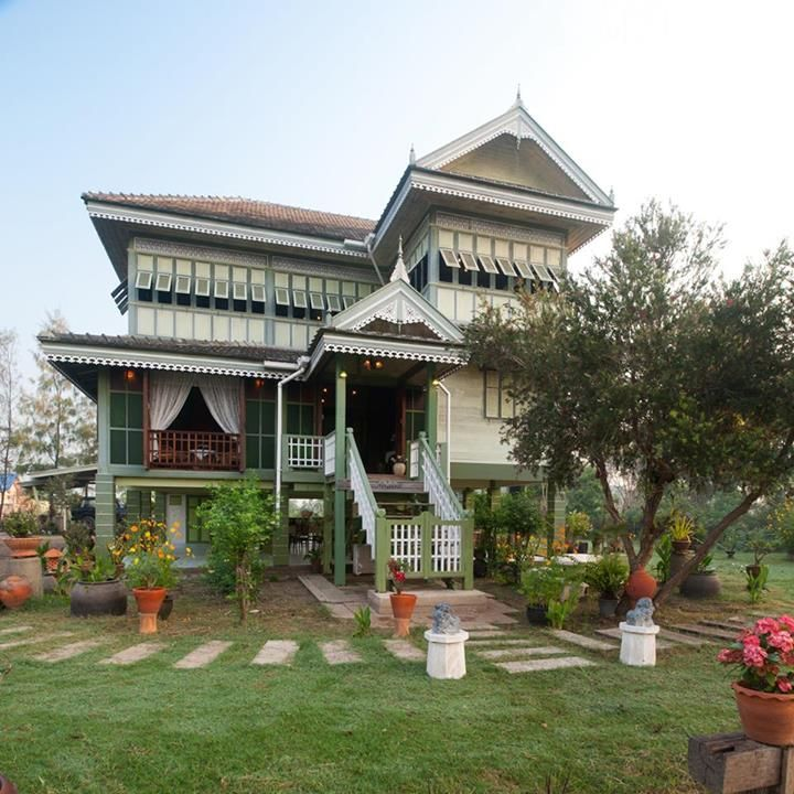 Thai House. Thai houses usually feature a bamboo or wooden structure, raised on stilts and topped with a steep gabled roof.
