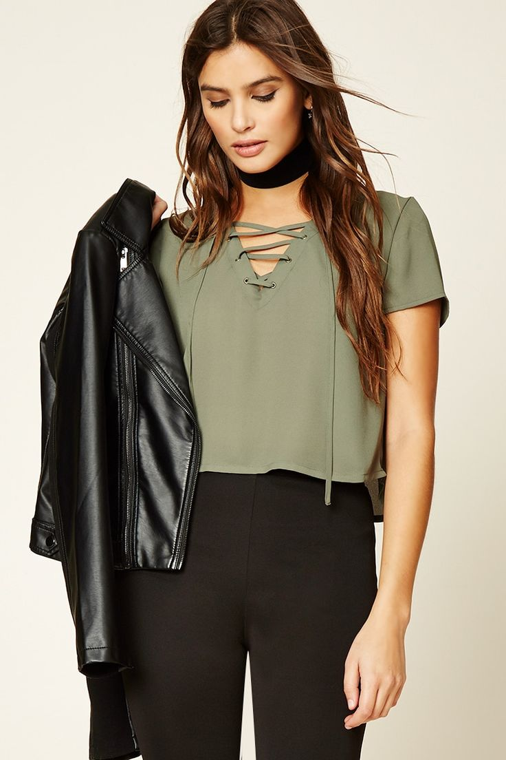 A woven top featuring a lace-up front with grommets, V-neckline, short sleeves, and a boxy silhouette.